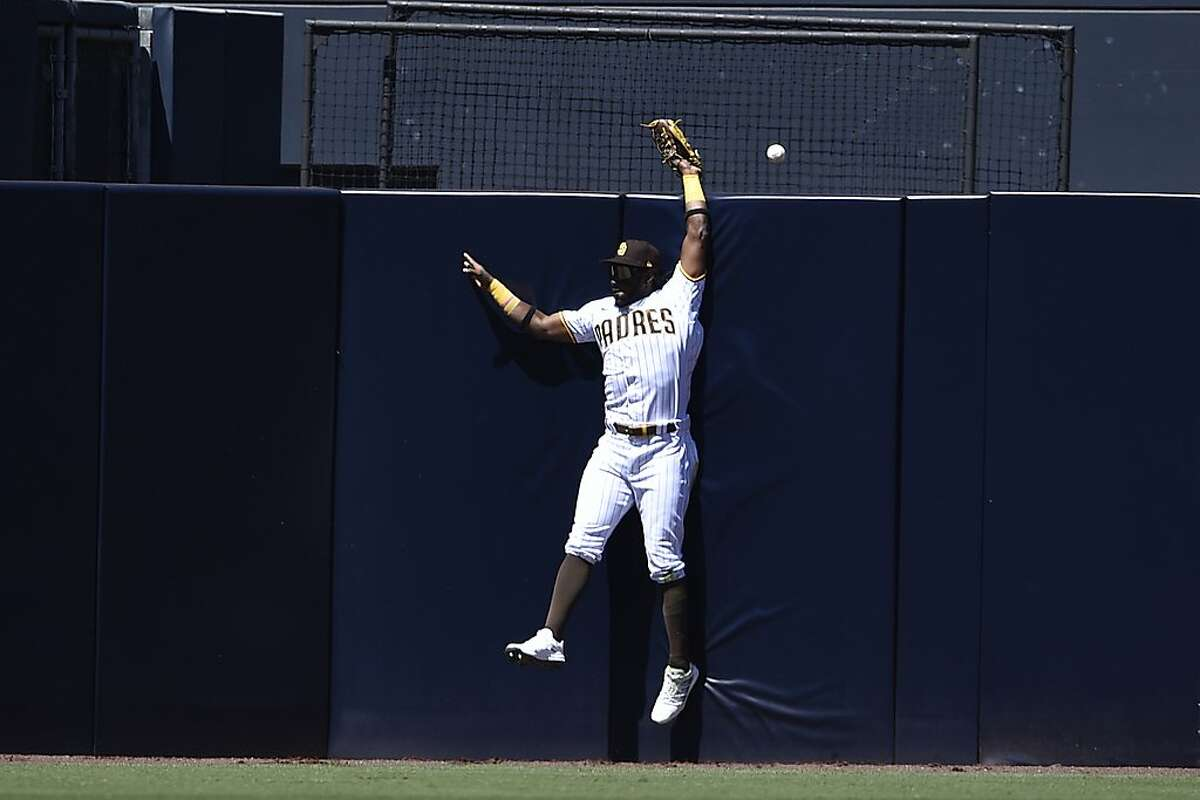 San Diego Padres center fielder Jorge Mateo is unable to make a catch for a two-run home run by San Francisco Giants' Darin Ruf during the second inning of a baseball game in San Diego, Wednesday, April 7, 2021. (AP Photo/Kelvin Kuo)