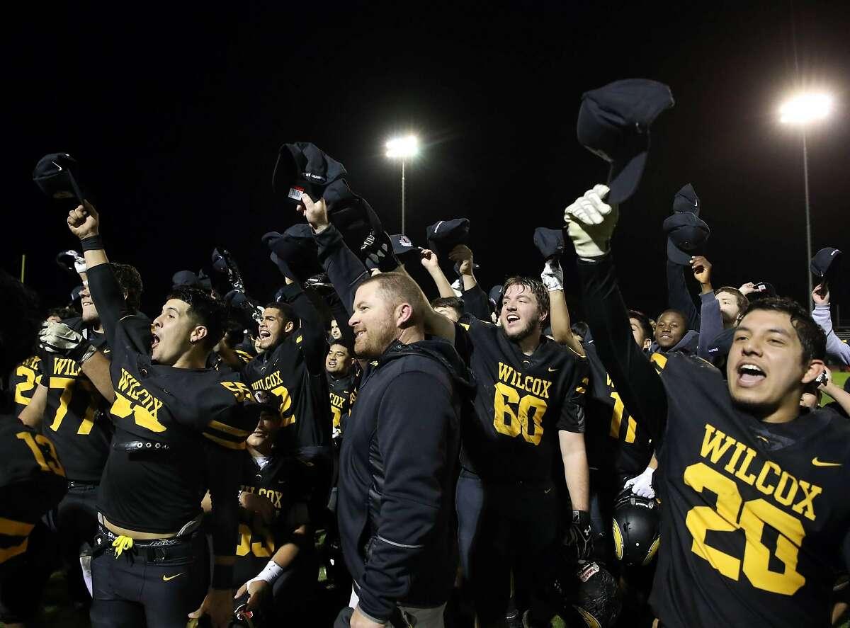 Wilcox-Santa Clara players and staff celebrate winning the 2018 state 3-A championship, 41-27 over Kaiser-Fontana.