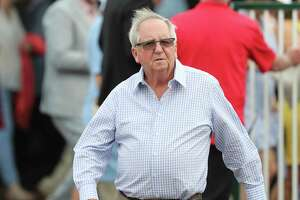 FILE - Trainer Claude 'Shug' McGaughey is seen at Churchill Downs in Louisville, Ky., in this Wednesday, May 1, 2019, file photo. McGaughey will run heavily favored Greatest Honour in Saturday's Florida Derby at Gulfstream Park, one of the last major prep races for the Kentucky Derby.