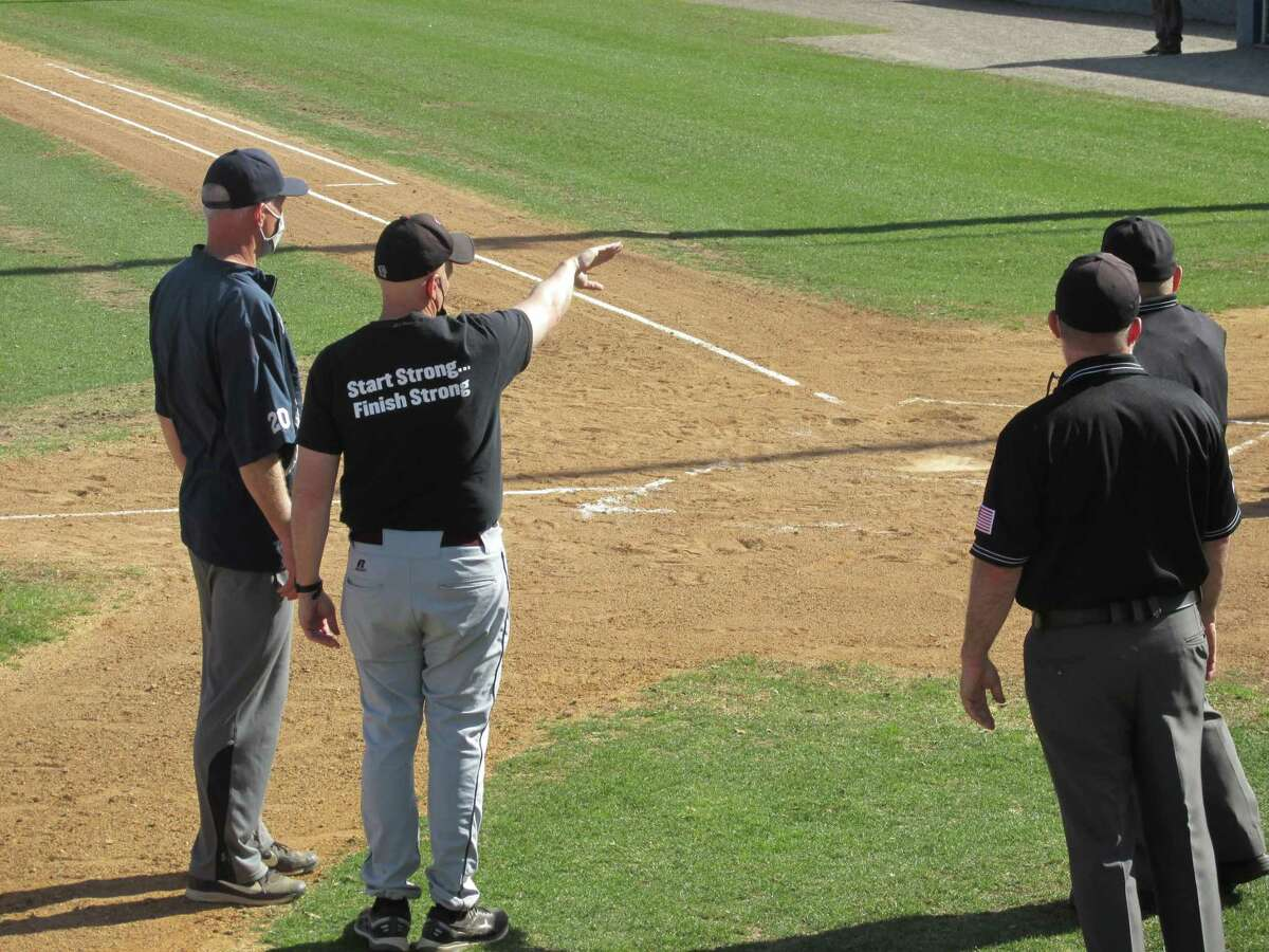 After a year without play, Torrington coach Pat Richardson goes over the Fuessenich Park rules with Shepaug coach Scott Werkhoven and the umpires before a scrimmage between the Berkshire League and NVL teams Wednesday afternoon.