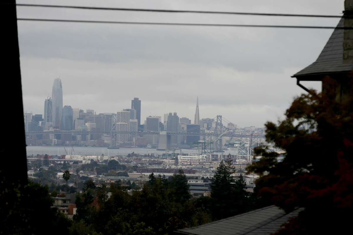 The San Francisco skyline is seen as dark cloudy skies hang over much of the Bay Area in this view from Piedmont, Calif., on Thursday, Oct. 19, 2017.