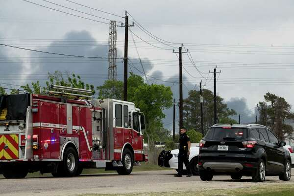 A Harris County Sheriff's Office deputy blocks Market Street, near Appelt Drive, as firefighters battled a fire at a chemical storage facility on the 1000 block of Lakeside Drive, on Wednesday, April 7, 2021, in Channelview.