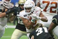 Roschon Johnson, running against Colorado in the Alamo Bowl, will remain a running back for new coach Steve Sarkisian.