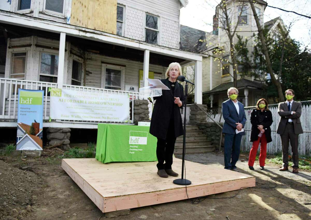HDF President and CEO Joan Carty speaks at the groundbreaking ceremony of Housing Development Fund's Community Land Trust affordable housing project located at 287 Washington Blvd. in Stamford, Conn. Wednesday, April 7, 2021. The project, expected to be completed by the spring of 2022, will bring 22 units of permanently-affordable homeownership to Stamford's South End.