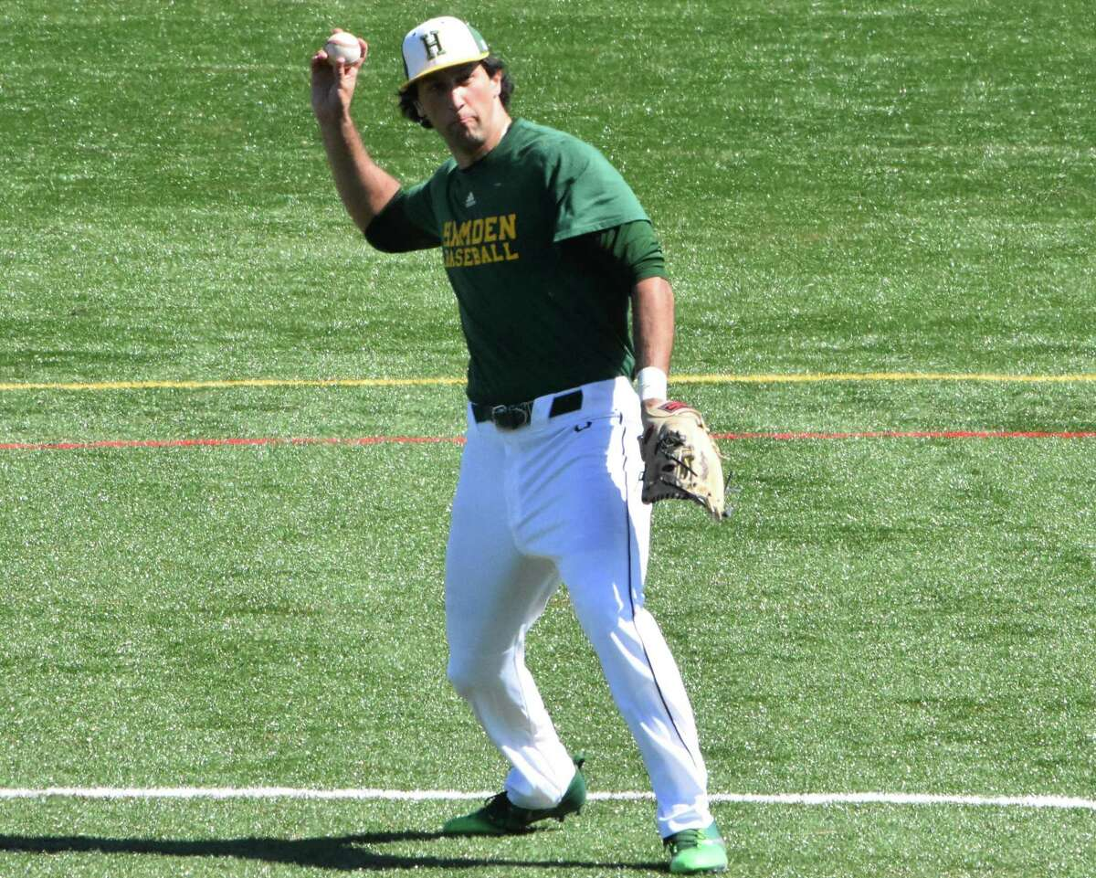 Hamden's Jake Pisano throws the ball from shortstop against Xavier in a scrimmage at Hamden high on Tuesday.