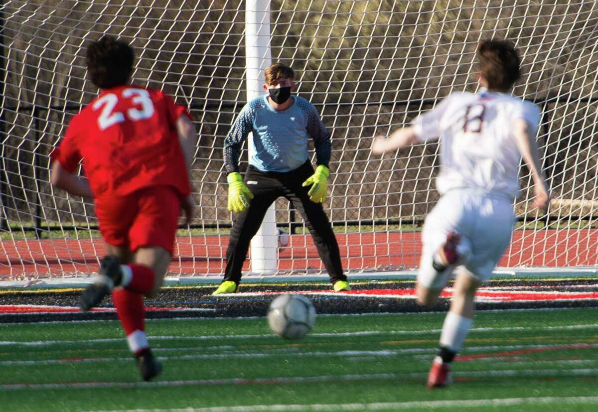 Stillwater goalkeeper Evan Coe anticipates action as Mechanicville?•s Tyler Tesoriero charges downfield trailed by Stillwater defender Ryan Henderson during a game on Wednesday, Apr. 7, 2021 in Mechanicville, N.Y. (Jenn March, Special to the Times Union )