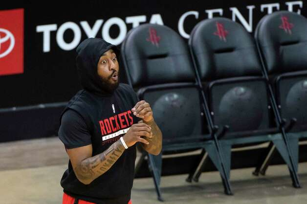 Houston Rockets guard John Wall (1) makes a face at Houston Rockets assistant coach John Lucas as Wall warms up before an NBA game between the Houston Rockets and Dallas Mavericks on Wednesday, April 7, 2021, at Toyota Center in Houston. Photo: Mark Mulligan, Staff Photographer / © 2021 Mark Mulligan / Houston Chronicle