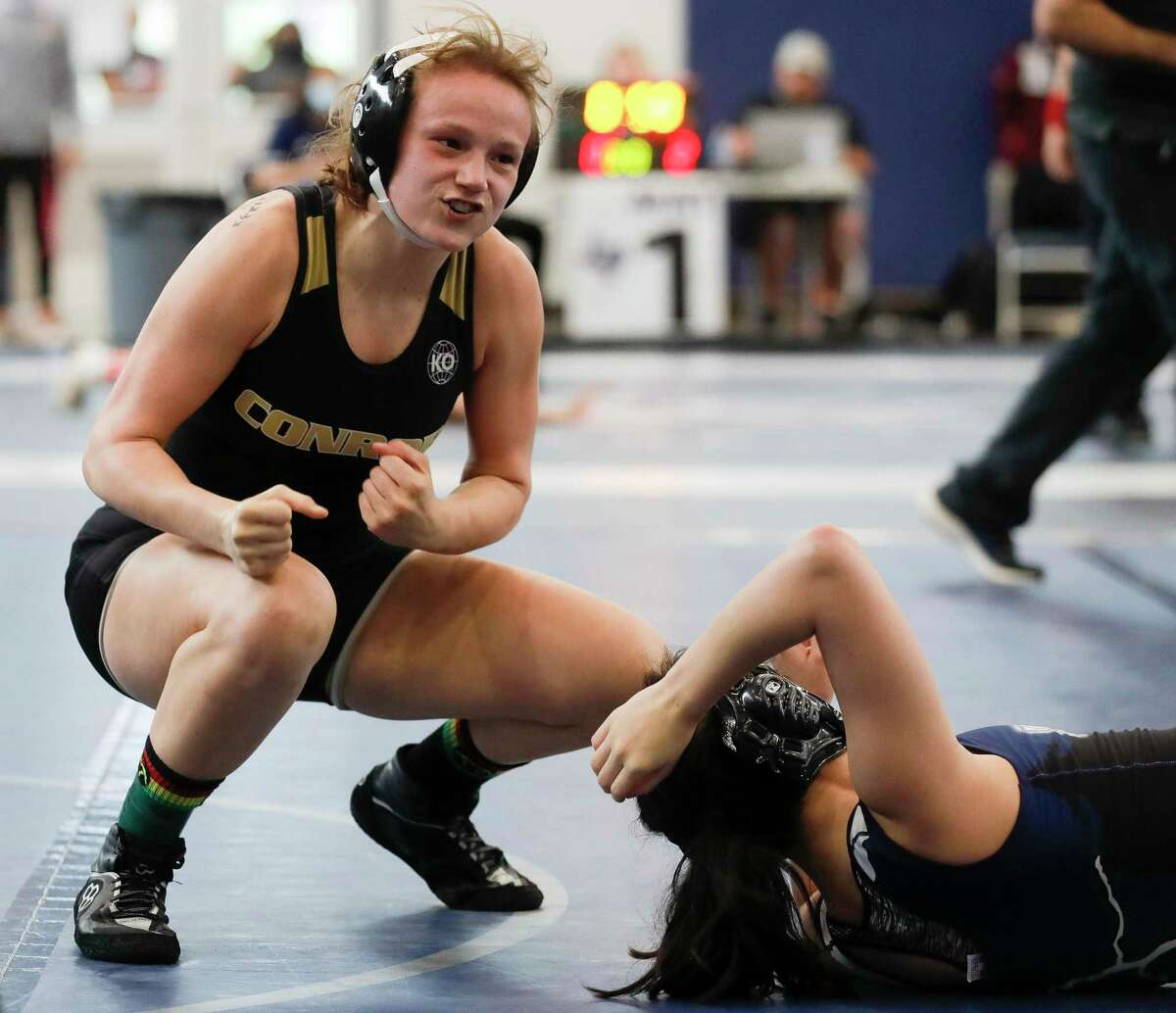 Michal Buska of Conroe reacts after defeating Maddie Trejo of Bryan in a 128-pound third-place bout during the District 8-6A high school wrestling tournament at Bryan High School, Wednesday, April 7, 2021, in Bryan.