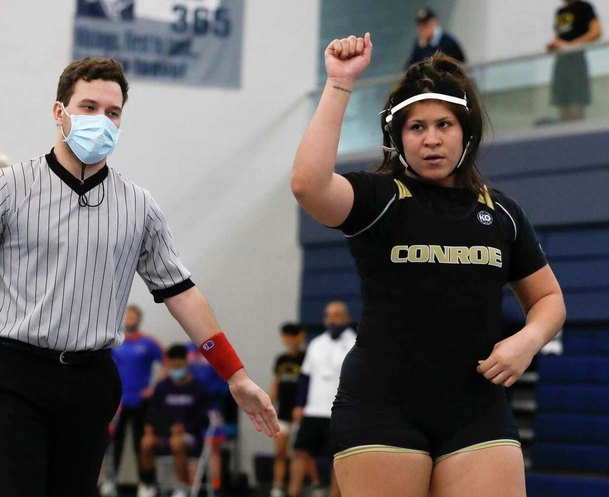 Lessly Sandoval of Conroe raises her first after winning her 215-pound championship bout during the District 8-6A high school wrestling tournament at Bryan High School, Wednesday, April 7, 2021, in Bryan.