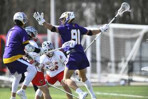 UAlbany defenseman Elijah Gash, right, of the men's lacrosse team. (Steve McLaughlin/ UAlbany Athletics)