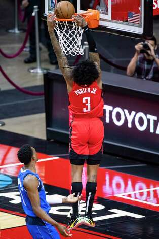 Houston Rockets guard Kevin Porter Jr. (3) dunks during the first quarter of an NBA game between the Houston Rockets and Dallas Mavericks on Wednesday, April 7, 2021, at Toyota Center in Houston. Photo: Mark Mulligan, Staff Photographer / © 2021 Mark Mulligan / Houston Chronicle