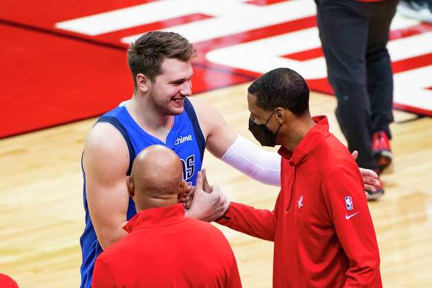 Dallas Mavericks guard Luka Doncic (77) greets Houston Rockets head coach Stephen Silas before the start of the first quarter of an NBA game between the Houston Rockets and Dallas Mavericks on Wednesday, April 7, 2021, at Toyota Center in Houston. Photo: Mark Mulligan, Staff Photographer / © 2021 Mark Mulligan / Houston Chronicle