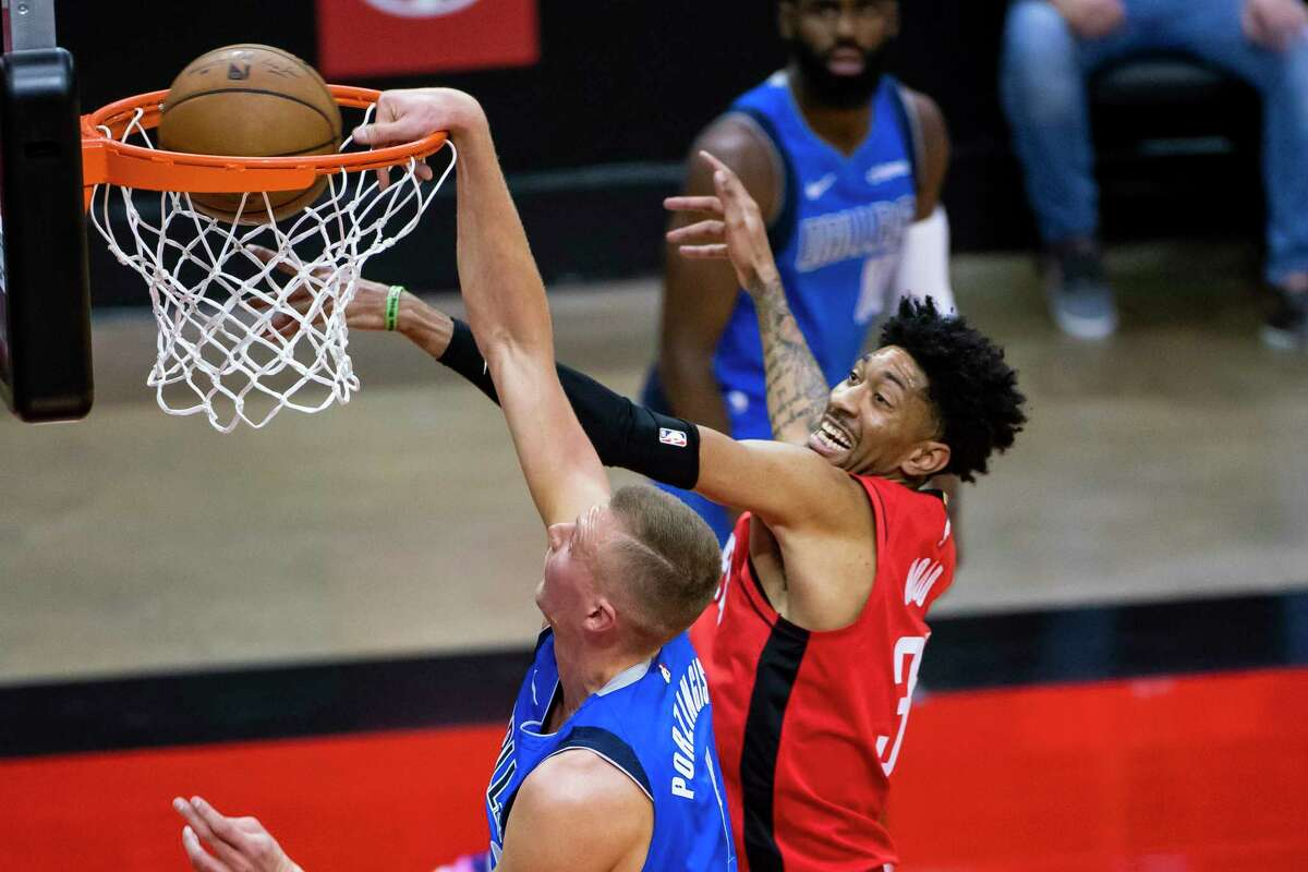 Houston Rockets center Christian Wood (35) tries to stop a shot by Dallas Mavericks center Kristaps Porzingis (6) during the first quarter of an NBA game between the Houston Rockets and Dallas Mavericks on Wednesday, April 7, 2021, at Toyota Center in Houston.