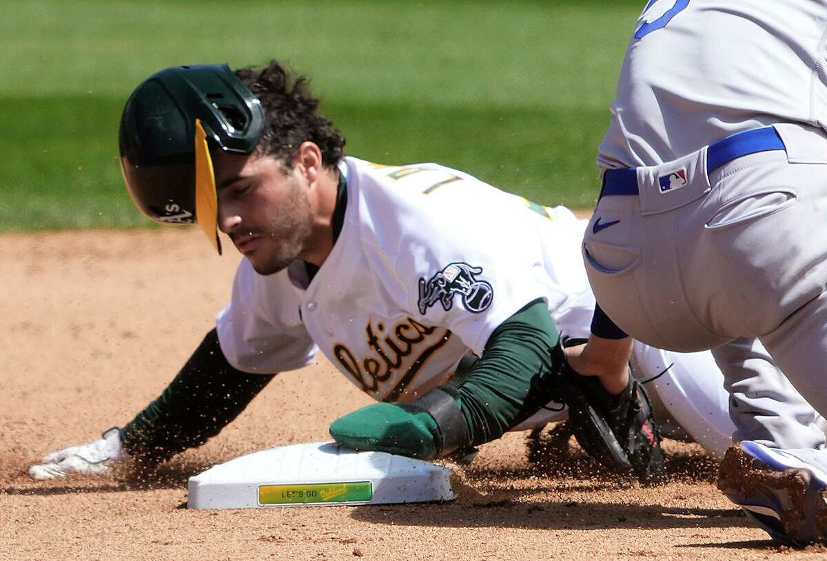 Former Astros farmhand Ramon Laureano swipes second base in the fourth inning of Wednesday's 4-3 win over the Dodgers. Laureano would then steal third before scoring on a wild pitch.