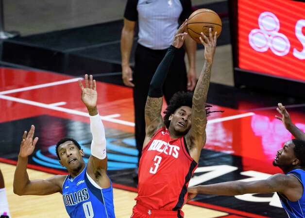 Houston Rockets guard Kevin Porter Jr. (3) tries to hold onto the ball during the second quarter of an NBA game between the Houston Rockets and Dallas Mavericks on Wednesday, April 7, 2021, at Toyota Center in Houston. Photo: Mark Mulligan, Staff Photographer / © 2021 Mark Mulligan / Houston Chronicle