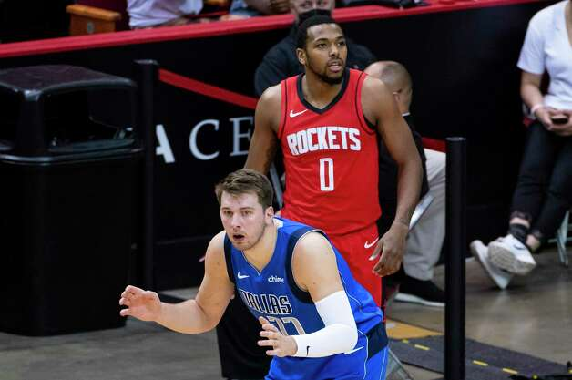 Dallas Mavericks guard Luka Doncic (77) reacts to a foul call on a three point attempt by Houston Rockets forward Sterling Brown (0) during the second quarter of an NBA game between the Houston Rockets and Dallas Mavericks on Wednesday, April 7, 2021, at Toyota Center in Houston. Photo: Mark Mulligan, Staff Photographer / © 2021 Mark Mulligan / Houston Chronicle