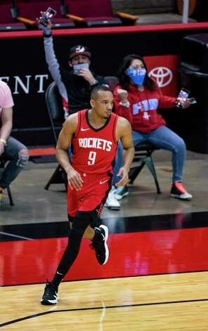 Houston Rockets guard Avery Bradley (9) runs back down court after hitting a three pointer during the second quarter of an NBA game between the Houston Rockets and Dallas Mavericks on Wednesday, April 7, 2021, at Toyota Center in Houston. Photo: Mark Mulligan, Staff Photographer / © 2021 Mark Mulligan / Houston Chronicle
