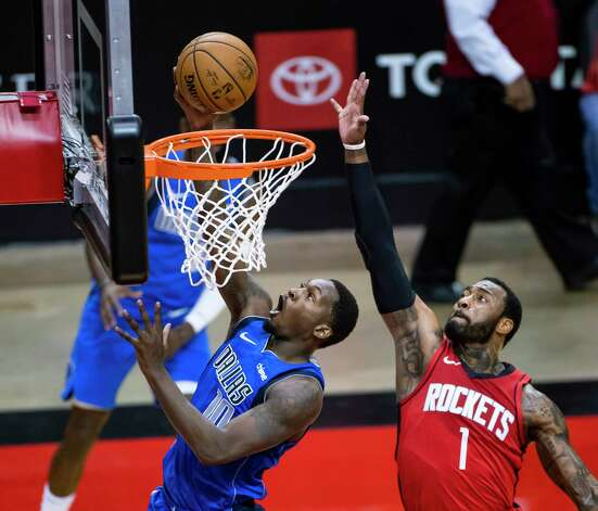 Dallas Mavericks forward Dorian Finney-Smith (10) shoots past Houston Rockets guard John Wall (1) during the second quarter of an NBA game between the Houston Rockets and Dallas Mavericks on Wednesday, April 7, 2021, at Toyota Center in Houston. Photo: Mark Mulligan, Staff Photographer / © 2021 Mark Mulligan / Houston Chronicle