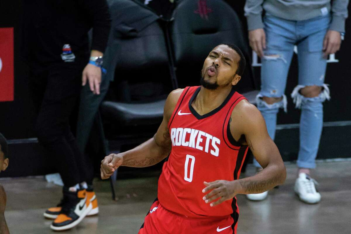 Houston Rockets forward Sterling Brown (0) reacts after missing a three point shot during the third quarter of an NBA game between the Houston Rockets and Dallas Mavericks on Wednesday, April 7, 2021, at Toyota Center in Houston.
