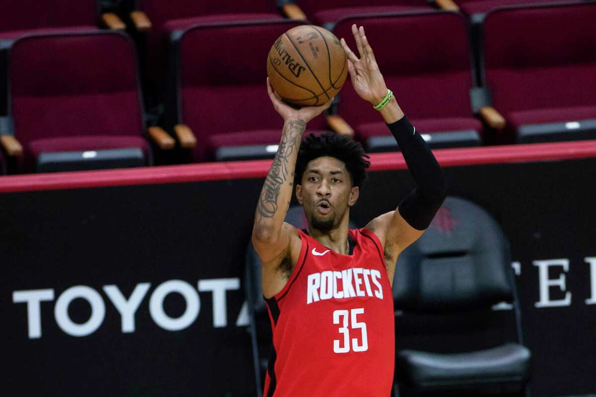 Houston Rockets center Christian Wood (35) shoots a three point shot during the third quarter of an NBA game between the Houston Rockets and Dallas Mavericks on Wednesday, April 7, 2021, at Toyota Center in Houston.