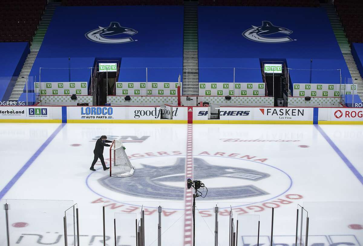 The Canucks' coronavirus issues - 21 players have tested positive - figure to keep the team off the ice for a while.
