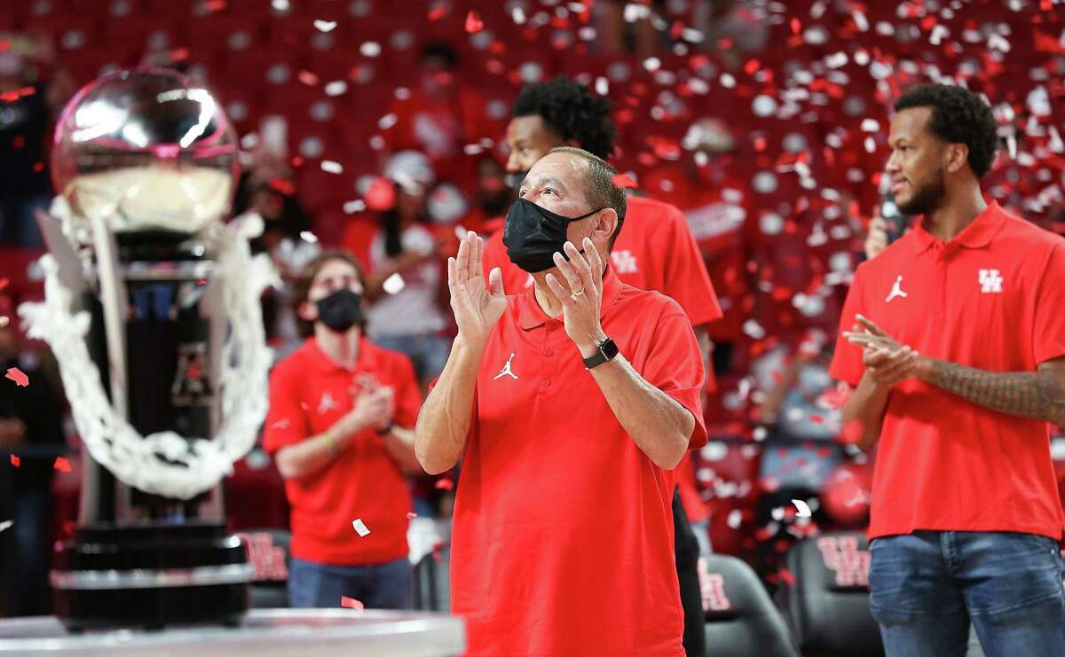 Surrounded by his players, UH basketball coach Kelvin Sampson enjoys a confetti shower at Wednesday night's celebration of the Cougars' Final Four appearance.