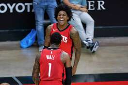 Houston Rockets guard Kevin Porter Jr. (3) celebrates his dunk to give the Rockets a seven point lead with Houston Rockets guard John Wall (1) during the fourth quarter of the Houston Rockets 102-93 win over the Dallas Mavericks on Wednesday, April 7, 2021, at Toyota Center in Houston.