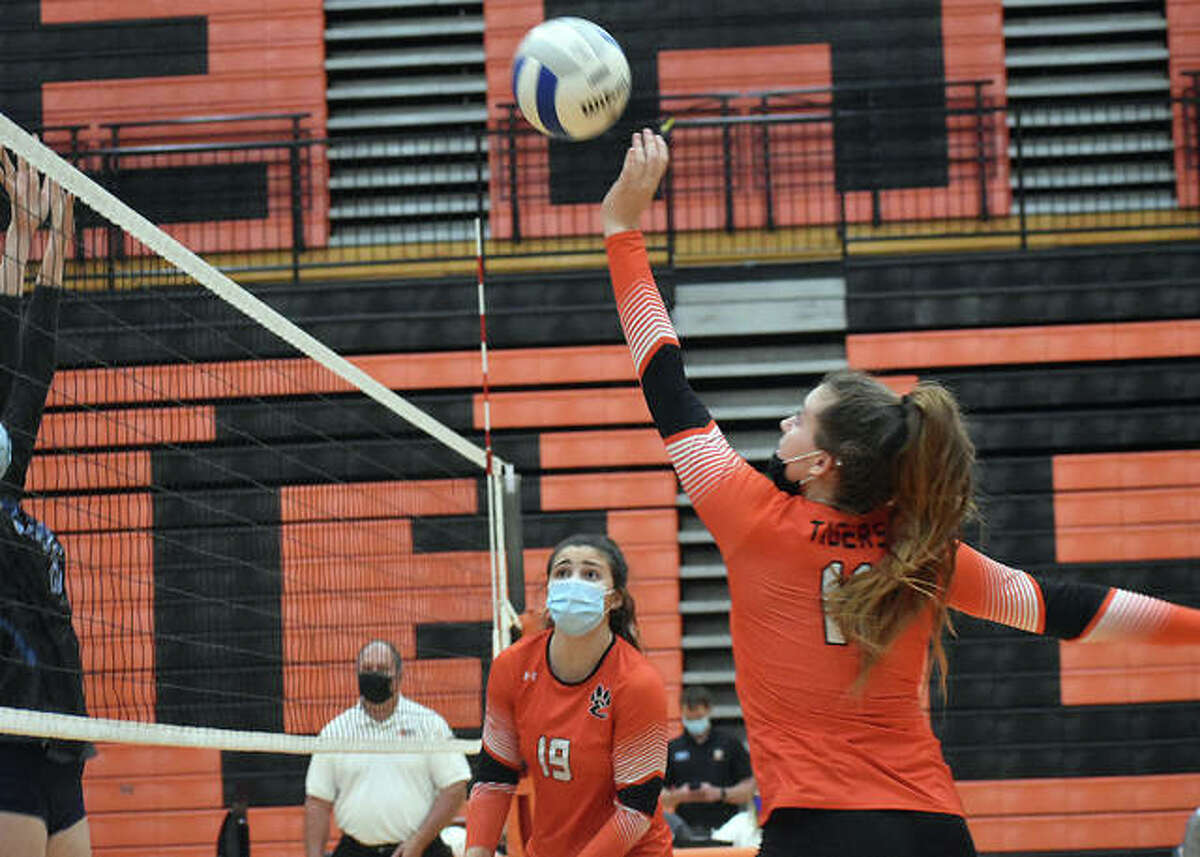 Edwardsville's Gabby Saye attempts to tip a shot over the net against Belleville East in the first game of the Southwestern Conference Tournament semifinals on Wednesday in Edwardsville.