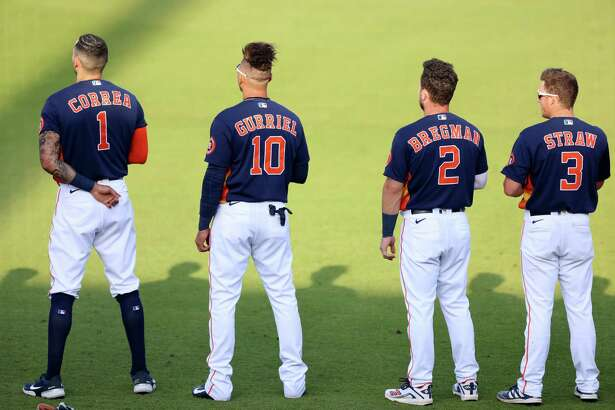 WEST PALM BEACH, FLORIDA - MARCH 19: (L-R) Carlos Correa #1, Yuli Gurriel #10, Alex Bregman #2, and Myles Straw #3 of the Houston Astros stand during the National Anthem prior to the spring training game against the Washington Nationals at the FITTEAM Ballpark of The Palm Beaches on March 19, 2021 in West Palm Beach, Florida.
