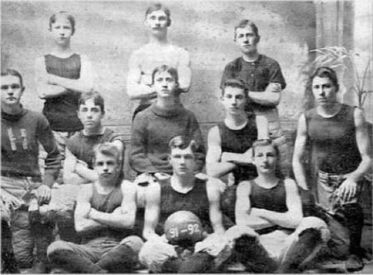 A group of basketball fans and historians who believe basketball was played in Herkimer, New York, months before the recorded Dec. 12, 1891 date of its creation by James Naismith in Springfield, Mass., point to the dates on the basketball held front and center as evidence a team in Herkimerwas playing the game months before its recorded date of invention.This photo of the first Herkimer YMCA team, with Lambert Will seated in the middle of the second row, is pointed to as evidence that this team played beforeNaismith's team in Springfield did.