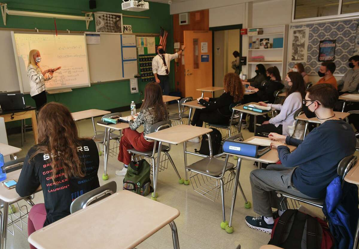 Teacher Katie Poole's calculus students enjoy a return to a full classroom for the first time in a year at Ludlowe High School in Fairfield, Conn. on Tuesday, March 9, 2021.