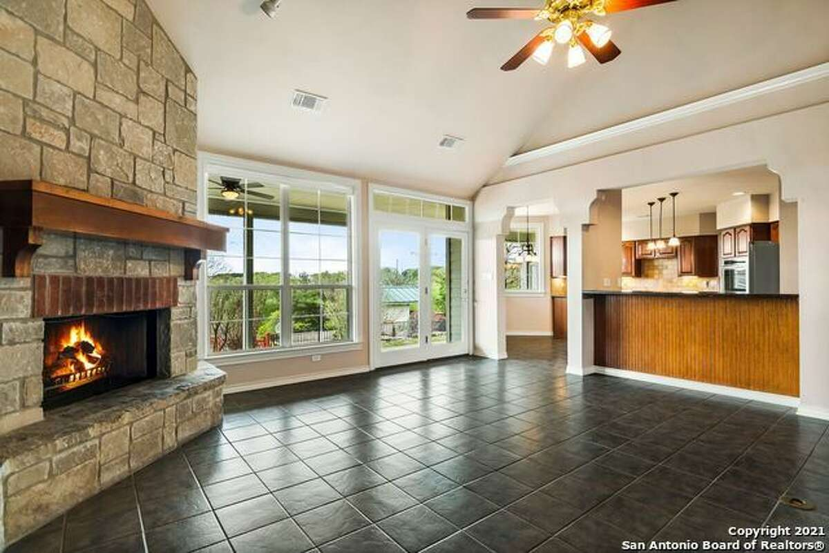 30235 CLOUD VIEW DR. - BULVERDE 4 beds 3 baths for $750,000A massive deck is complete with a covered outdoor kitchen.