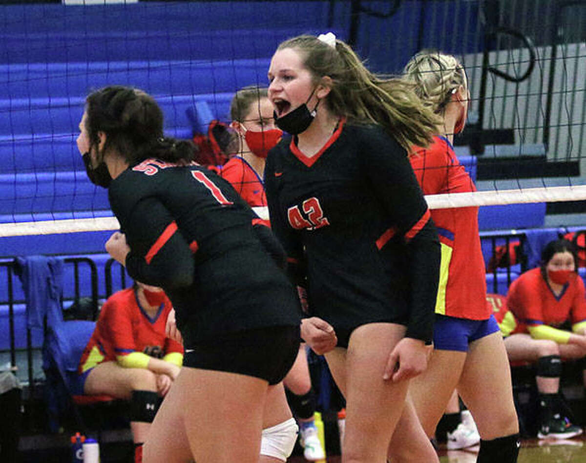 Staunton's Kennedy Legendre (42) and Savannah Billings (1) celebrate a point in a March 22 match at Roxana. On Wednesday, Legendre had a career-high 10 kills in the unbeaten Bulldogs' three-set victory at Williamsville.
