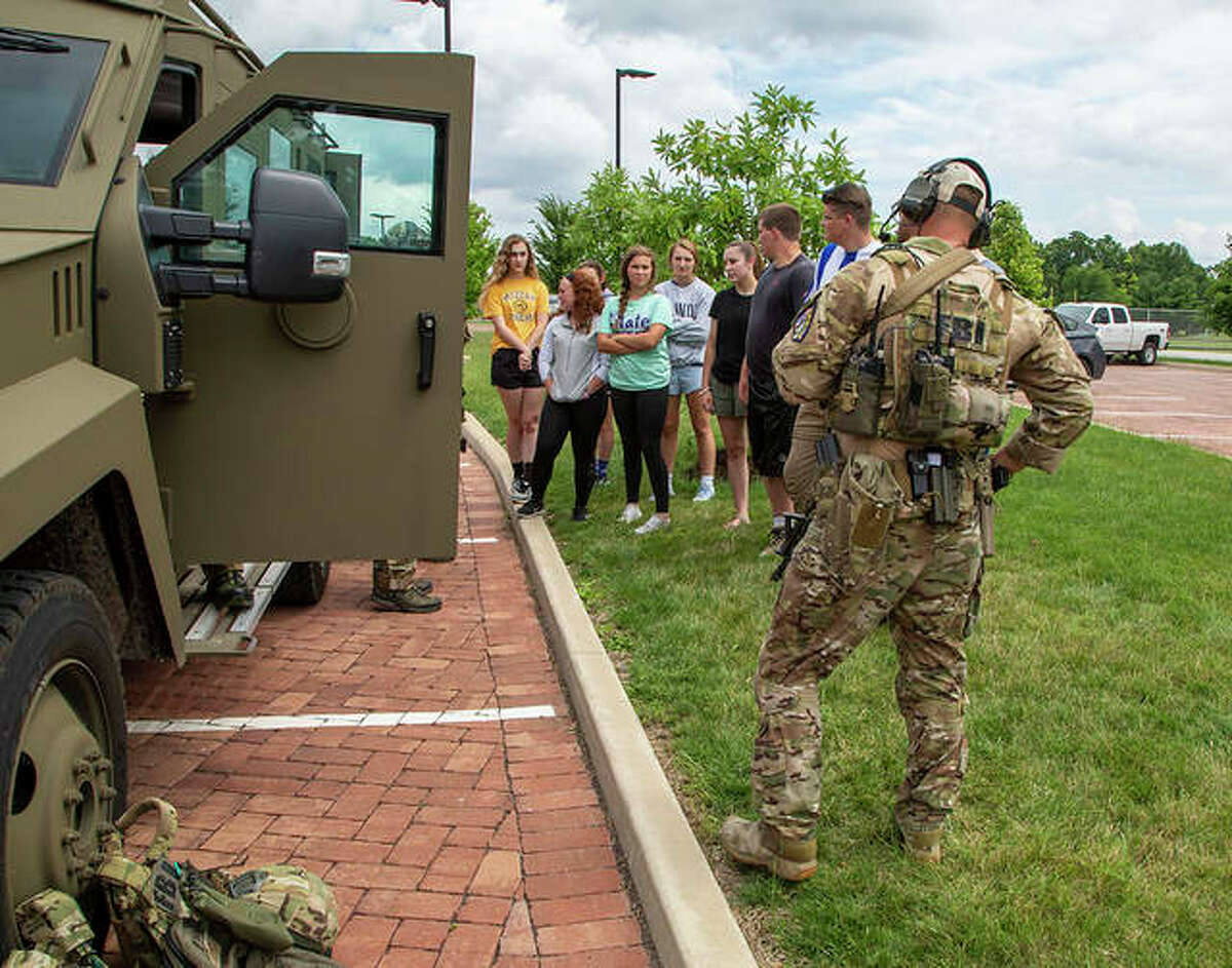 Students watch a presentation on FBI Special Weapons and Tactics teams during the 2019 Future Agents in Training Academy at Lewis and Clark Community College in Godfrey.