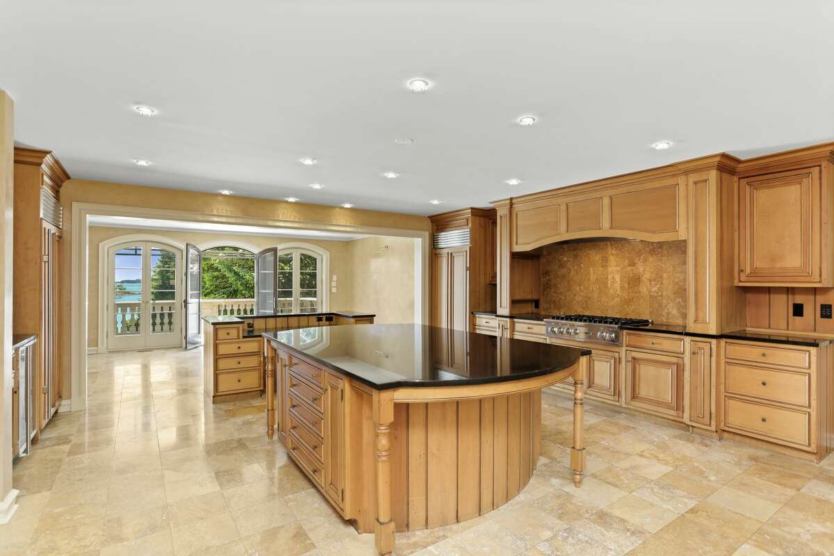 A massive island and granite countertops complete the kitchen at 136 Field Point Circle in Greenwich.