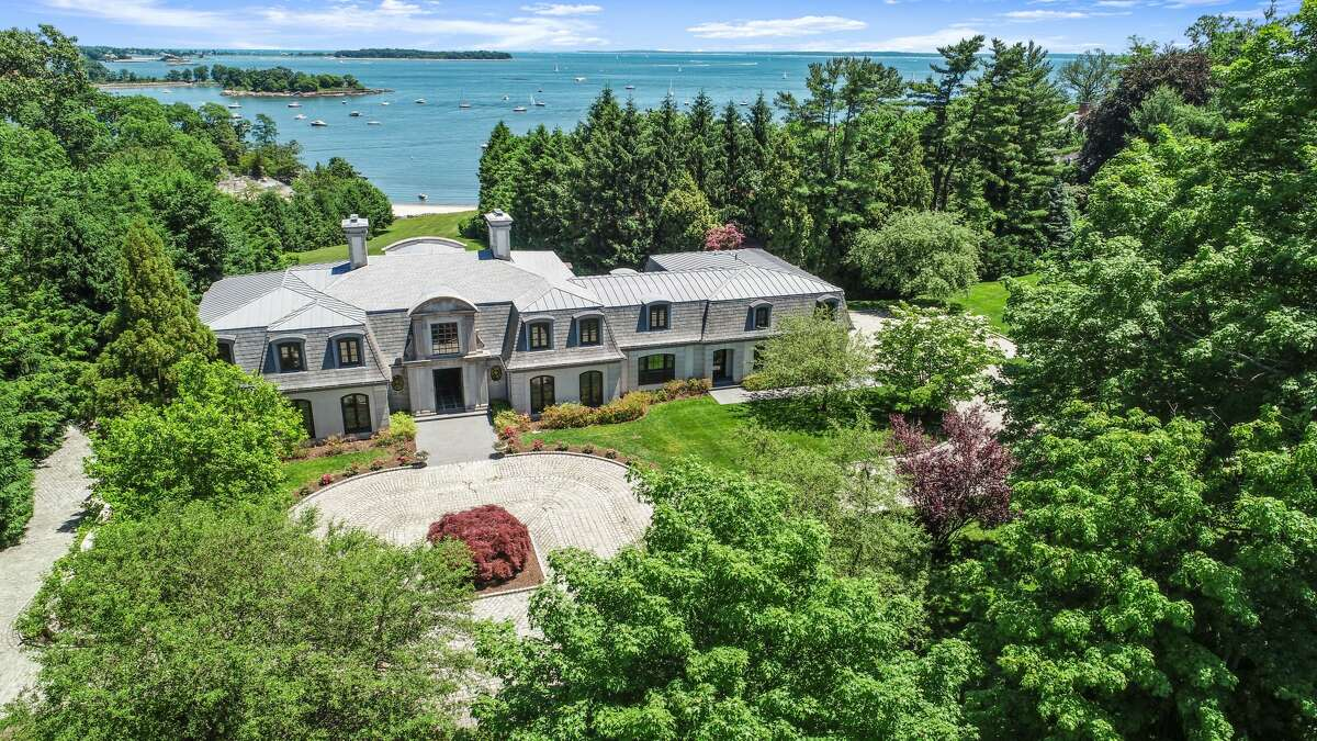 The home at 136 Field Point Circle in Greenwich is 9,718 square feet and has four bedrooms, nine bathrooms - six full and three half  - and a seven-space detached garage.
