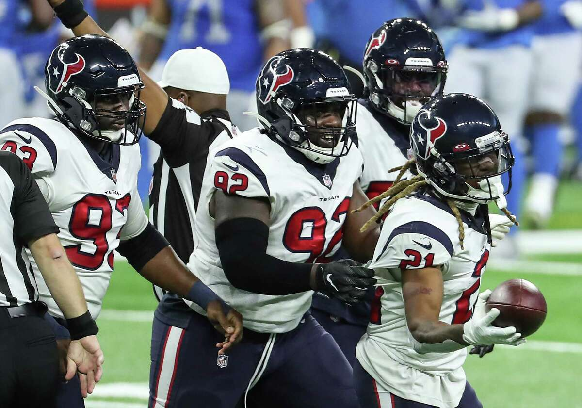 Houston Texans cornerback Bradley Roby (21) runs off the field with the ball after recovering a fumble by Detroit Lions running back Jonathan Williams during the first quarter of an NFL football game at Ford Field Thursday, Nov. 26, 2020, in Detroit.