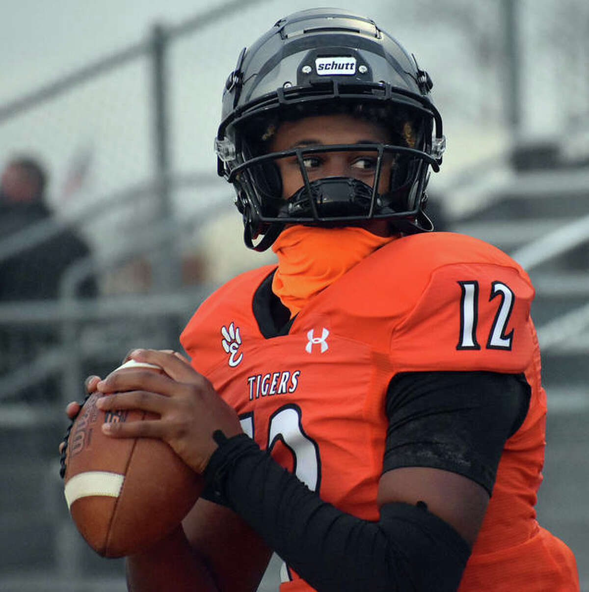 Edwardsville quarterback James Distaso-Hutchins warms up on the sideline prior to the start of a Week 2 game against Belleville East.