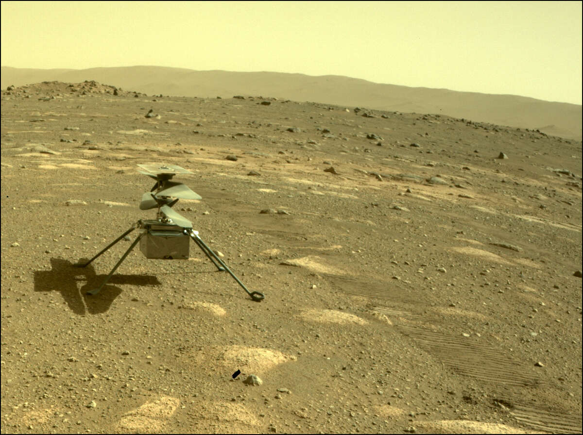 NASA's Ingenuity helicopter can be seen on Mars as viewed by the Perseverance rover's rear Hazard Camera on April 4, 2021.