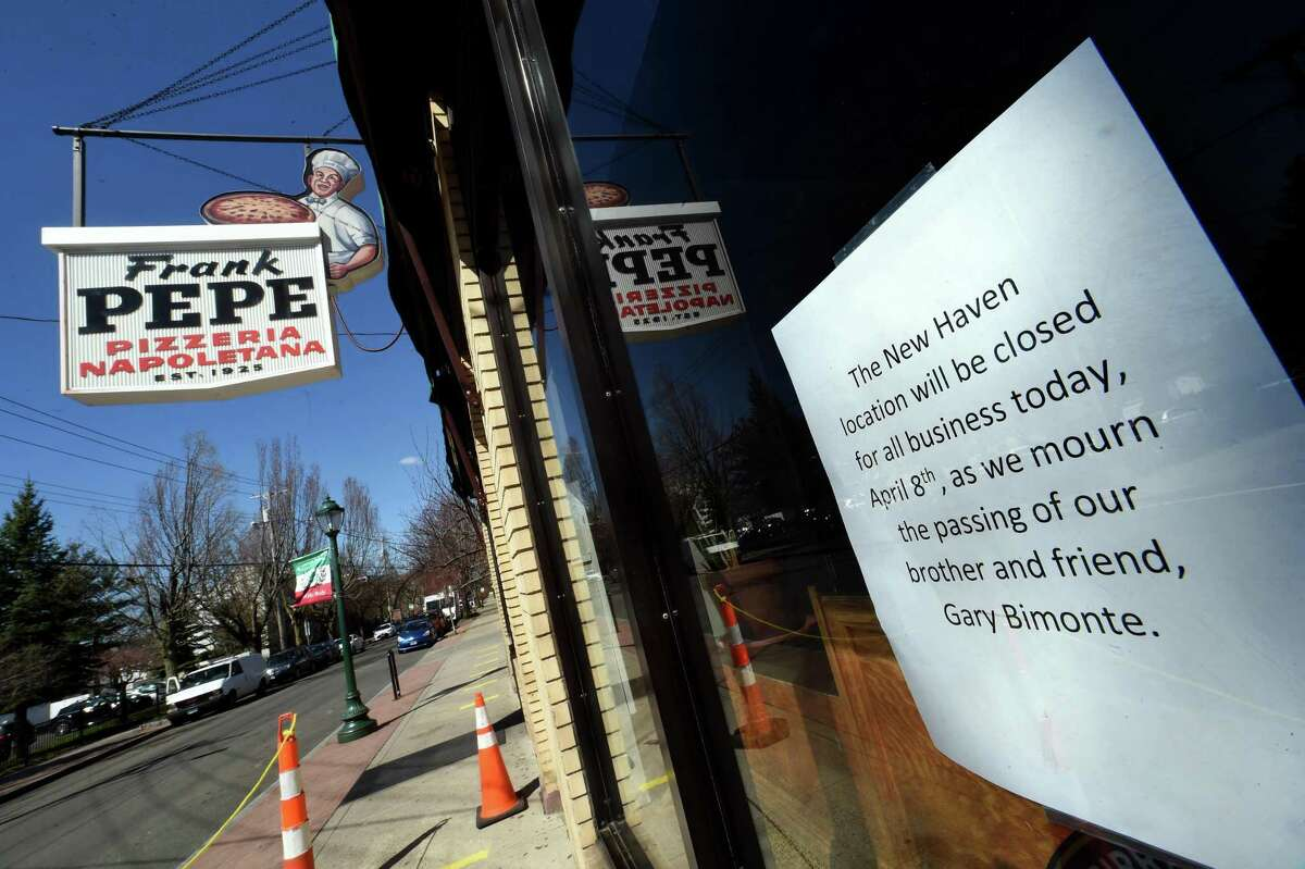 A sign on the front window of Frank Pepe Pizzeria Napoletana announces the closing of the restaurant for the day due to the passing of owner Gary Bimonte on April 8, 2021.