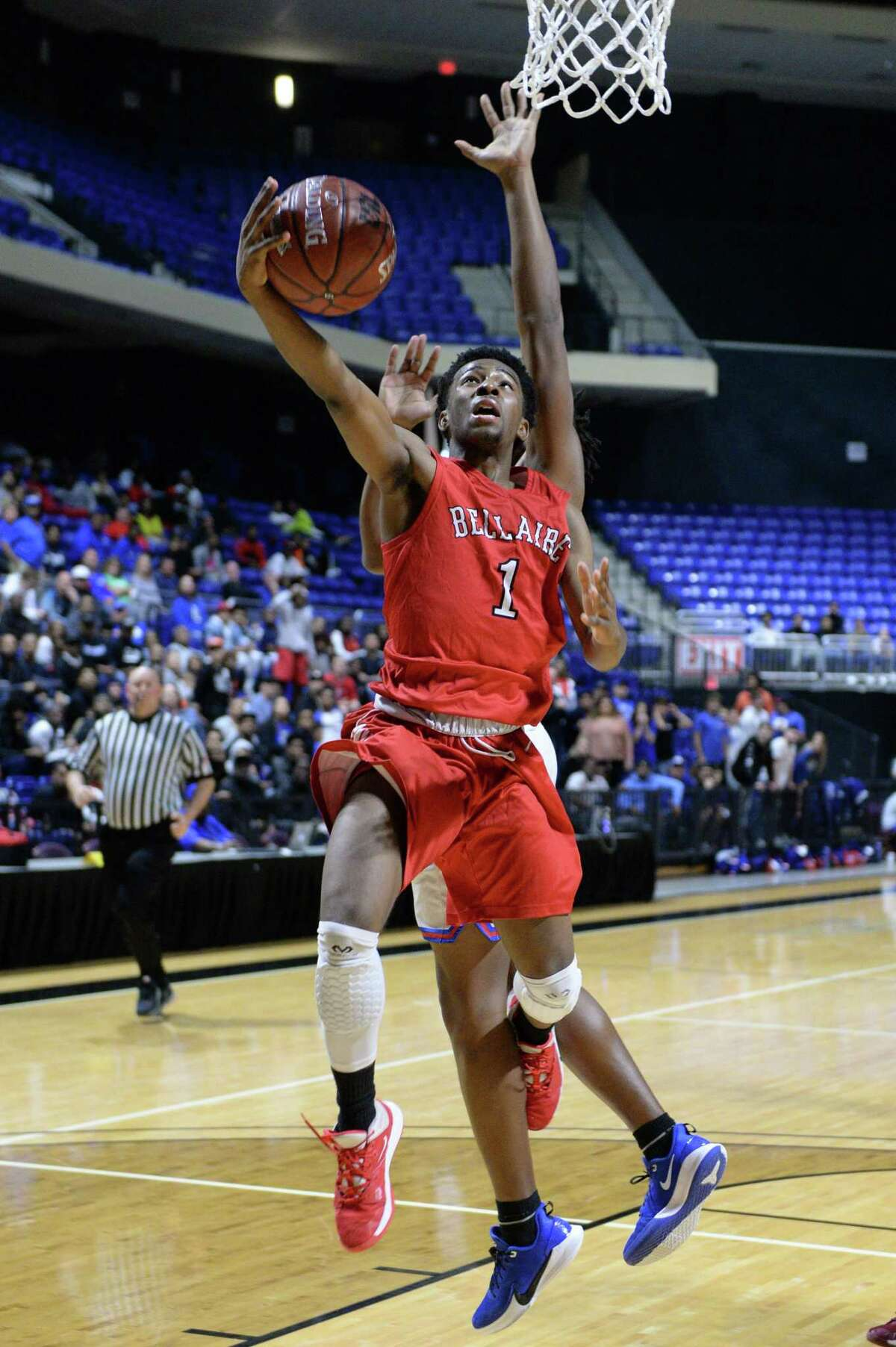 Elijah Lawrence (1) of Bellaire drives to the basket during the fourth quarter of the Boys 6A Region III championship basketball game between the Bellaire Cardinals and the Dickinson Gators on Saturday, March 7, 2020 at the Berry Center, Cypress, TX.