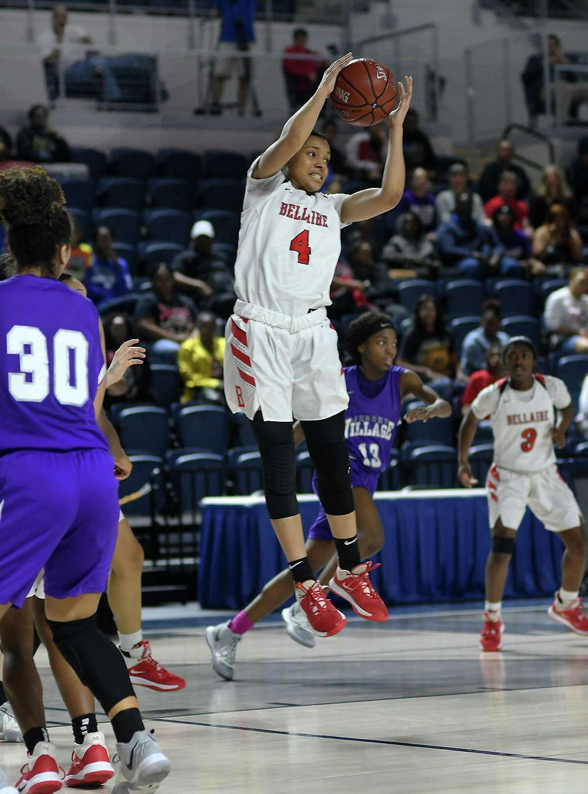Bellaire junior guard Ravyn Ellis (4) skies for a rebound against Jersey Village during the 4th quarter of their Region III-6A UIL Girls Basketball Bi-District playoff matchup at Delmar Fieldhouse in Houston on Feb. 17, 2020.