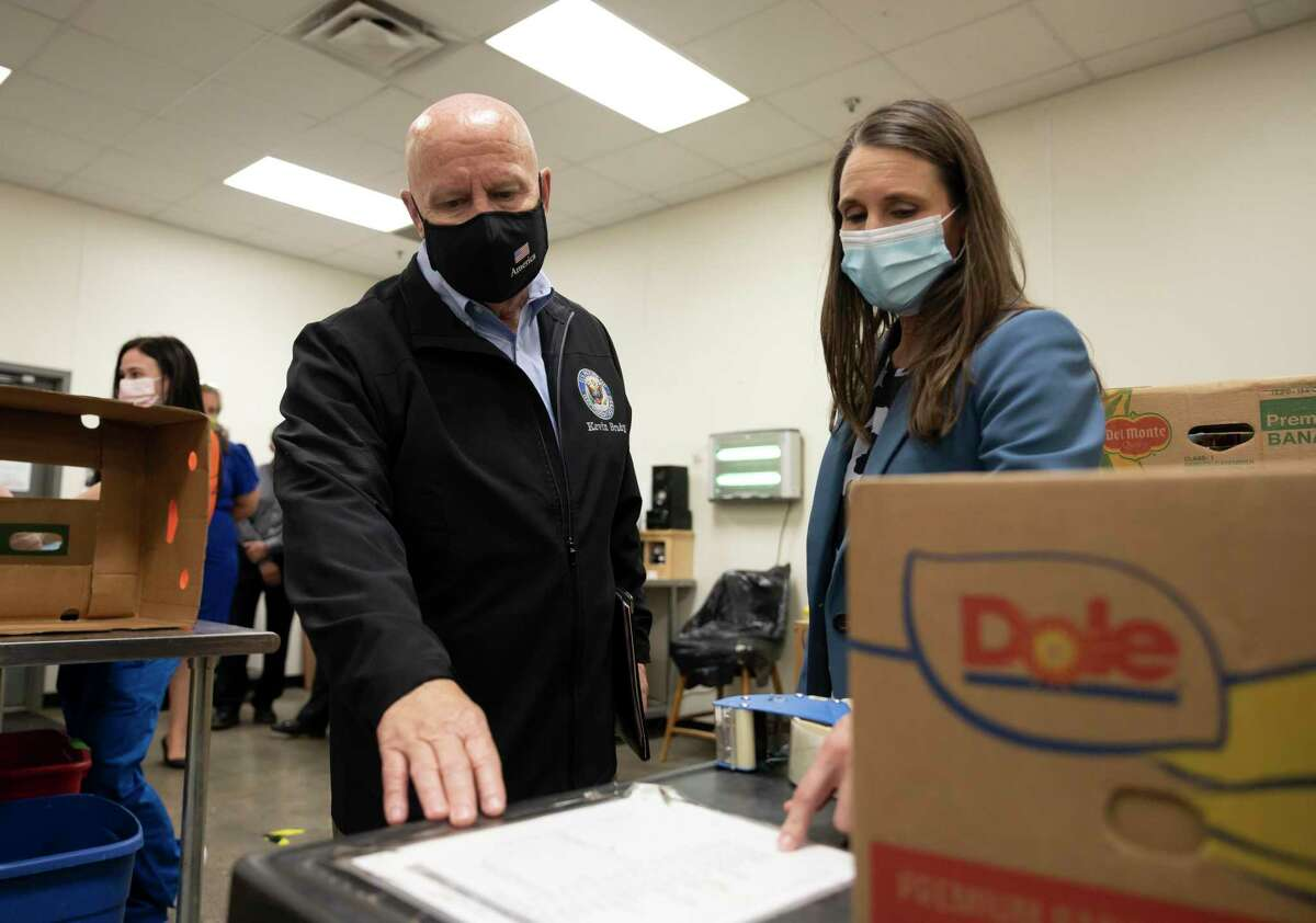 Montgomery County Food Bank president, Kristine Marlow, right, gives a tour of the food bank to Congressmen Kevin Brady, R-The Woodlands, Wednesday, April 8, 2021, in Conroe.