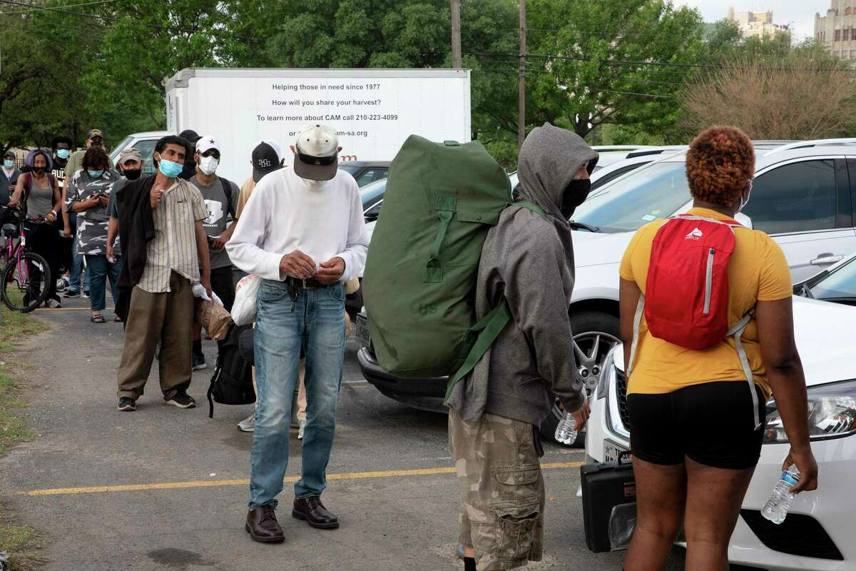 Unhoused people from around San Antonio wait outside of Christian Assistance Ministry to receive their vaccinations. CAM partnered with the San Antonio Fire Department and Metro Health to provide more than 70 vaccines.