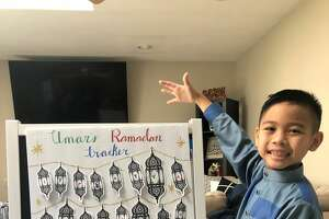 Umar Diep, 9, of Colonie displays his Ramadan tracker, where he adds a lantern for each day he fasts.