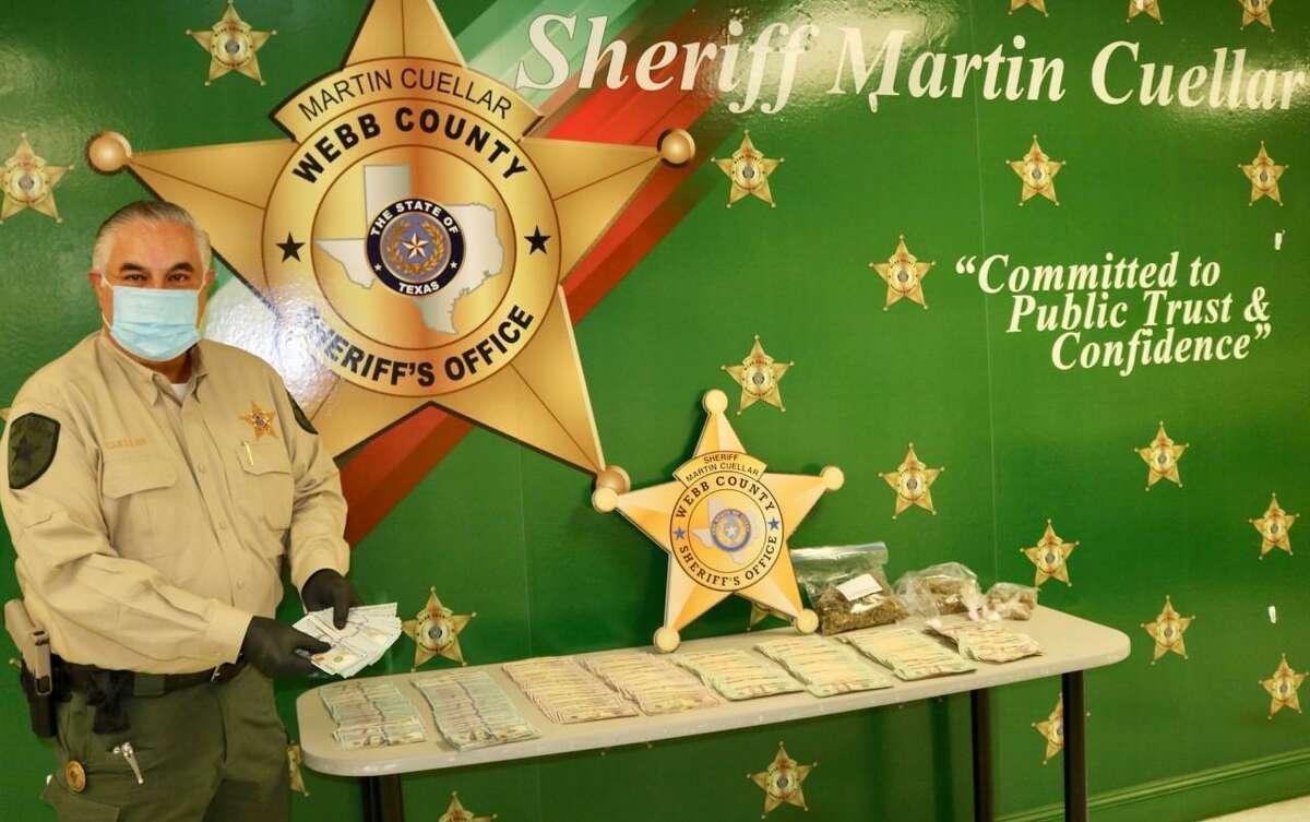 Webb County Sheriff Martin Cuellar said authorities seized cocaine, marijuana and $32,349 after raiding a home on Wednesday evening in the 1700 block of San Eduardo Avenue.