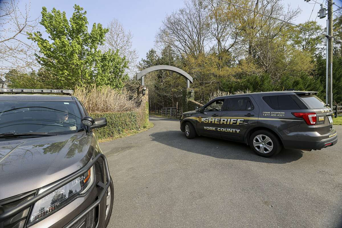 A York County sheriff's vehicle arrives at the site of a mass shooting in Rock Hill, S.C., at the home of Dr. Robert Lesslie, who was one of the five killed.
