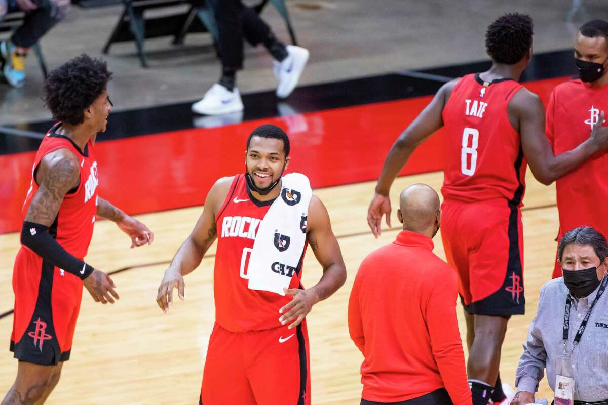 Houston Rockets forward Sterling Brown (0) celebrates at the end of the fourth quarter of the Houston Rockets 102-93 win over the Dallas Mavericks on Wednesday, April 7, 2021, at Toyota Center in Houston.