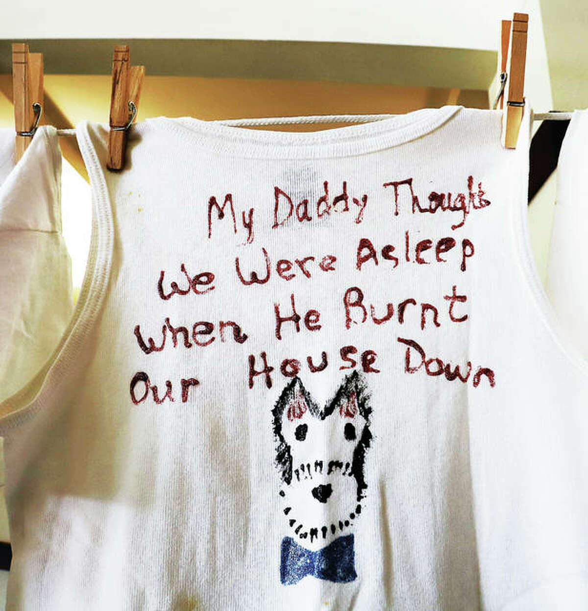 As in previous years, T-shirts decorated by children who have lived through domestic violence were hung from a clothesline describing the situation they each were involved in.
