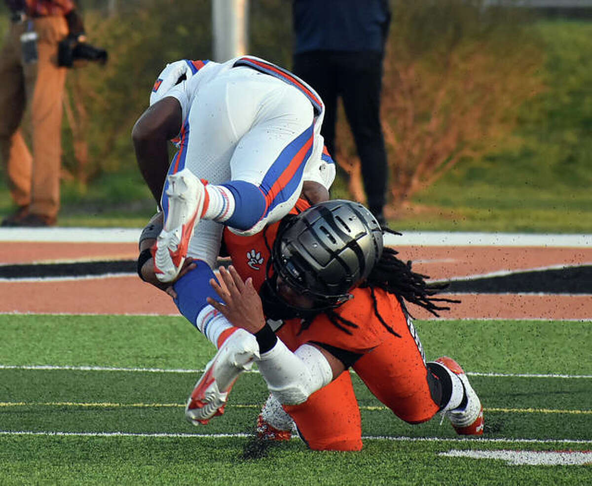 Edwardsville defensive back Torrence Johnson makes an open-field tackle during a Week 3 game against East St. Louis inside the District 7 Sports Complex.